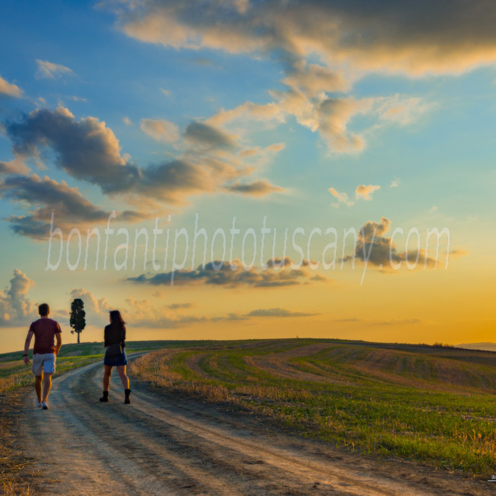 crete senesi landscape #89 country road with two hikers in mucigliani
